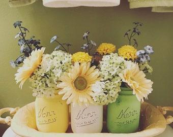 distressed mason jars, chalk painted mason jars, centerpiece mason jars, spring mason jars, summer mason jars, yellow, green, white jars