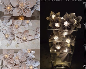 Handmade mini paper flowers with light centres
