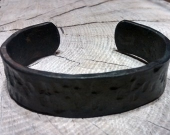 Blacksmithed hand-made wide hammered cuff bracelet in black iron