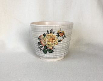 Romantic vintage flowerpot with diamonds and yellow roses
