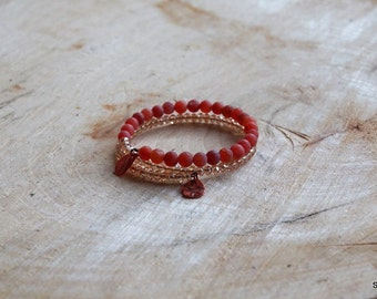 Beads bracelet in coral colour
