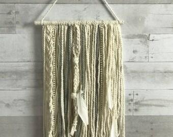 beaded yarn wall hanging