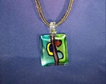 Hadmade glass pendant on beaded necklace
