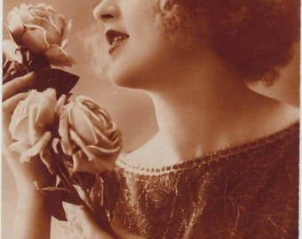 Rough winds do shake the darling buds of May | 1920's Postcard | Flapper Beauty | Buoyant Curls | Silken Roses | Umber Tones |