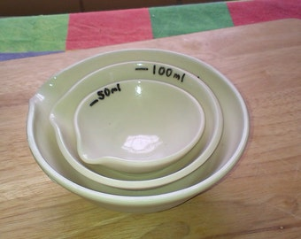 Hand thrown porcelain Measuring cups, 50, 100, and 150 ml.