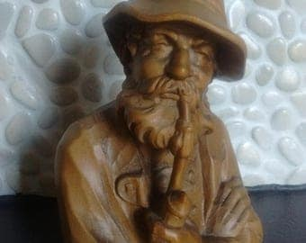 Carved wood bed and breakfast man with pipe-Austria