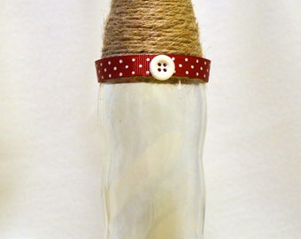 Red, white polka dot and twine bottle
