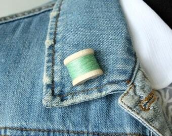 Mint Green Bobbin Lapel Pin - half a wooden bobbin with real thread