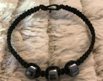 Black hemp rope bracelet with iridescent glass beads