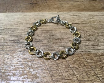 Silver and gold flower knot bracelet.