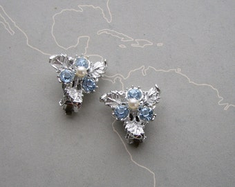 ice blue rhinestone clip on earrings, bright silver leaf earrings with pearl center . mid century costume jewelry