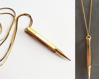 Gold vintage pencil necklace Swanky Like You Baby WRITES and has lead inside