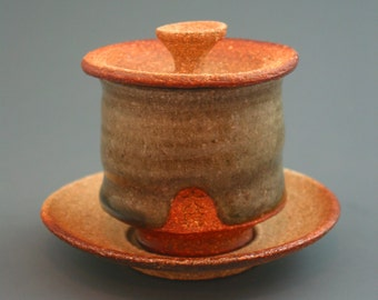 Lidded Cup and Saucer, woodfired stoneware w/ celadon and natural ash glazes