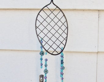 WIND CHIME REcycled from an antiQue Wire Whip with turquoise,navy blue and purple glass beads ,2 forks,1 knife and 1 long handle spoon