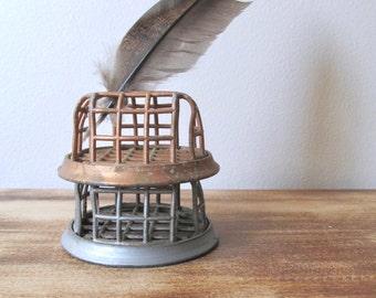 vintage metal flower frog silver or copper zinc iron cage dazey beagle vogue