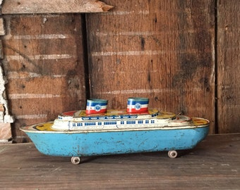 Authentic,  tin steamship pull toy. USS America, not a reproduction. Wyandotte Toys Lithograph tin toy