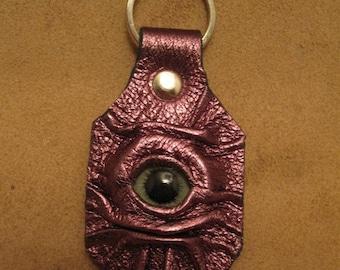 Grichels leather keychain - metallic purple with green carousel horse eye