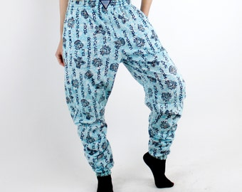 Vintage 80's printed cotton pants, turquoise with black tribal patterns, elastic waist and cuffs, side pockets - Small