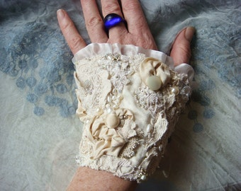 blanca - a delicate hand embroidered collage bridal wrist cuff in cream and ivory