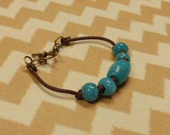Large Boho Turquoise Glass Beads on Brown Waxed Cotton Cord Bracelet with Antiqued Gold Plated Brass Toggle Clasp