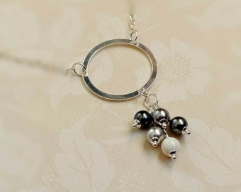 Sterling Silver Circle Necklace with a Range of Gray Swarovski Crystal Pearls