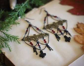 filigree bat earrings with chain detail and black howlite crosses