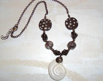 Kazuri Bead Necklace with Fair Trade Clay Beads from Kenya Satin Cream Sea Shell Pendant Jazzy Pita Pats and Handmade Brass Beads