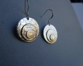 Silver disk earrings.