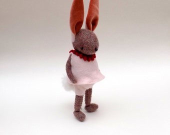 Woollen Bunny  -  Handmade plush rabbit wearing pink felt pants and matching felt tunic with a red neck piece.