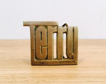 """Vintage """"Terry"""" Solid Brass Metal Belt Buckle by Baron Buckle 1978"""