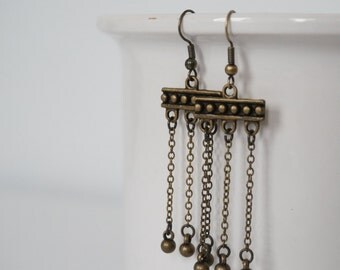 Totem earrings bronze.