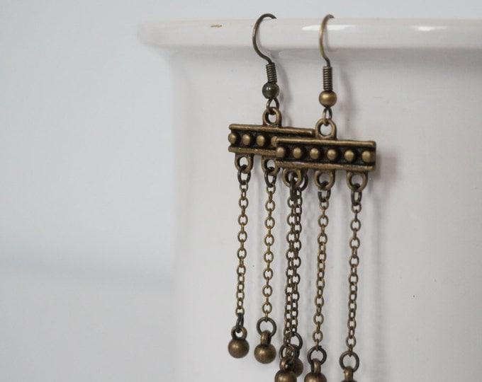 Totem earrings bronze.