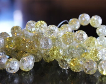 80 approx. yellow and clear, 10 mm crackle glass beads, 1.5mm hole