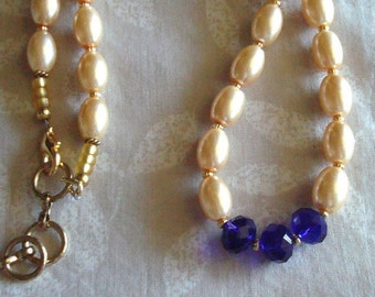 Pearl necklace, Pale yellow with Cobalt blue accent beads. Gold accents, wedding jewelry