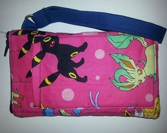 Pokemon wristlet with zippered top and front pocket