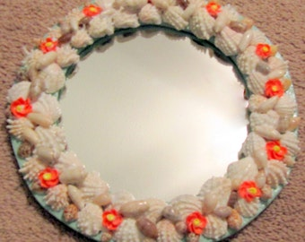 Mirror with white shells and small orange flower shells