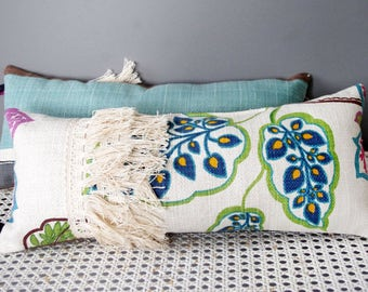 Small teal blue cushion for back comfort