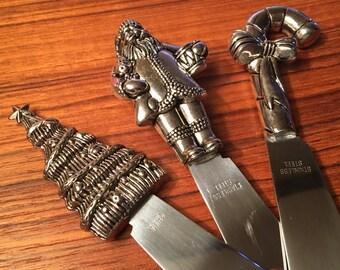 Set of three stainless steel Christmas spreaders