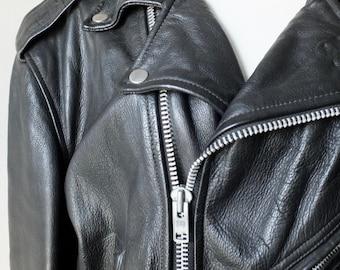 1980s biker jacket + Vintage black motorcycle jacket