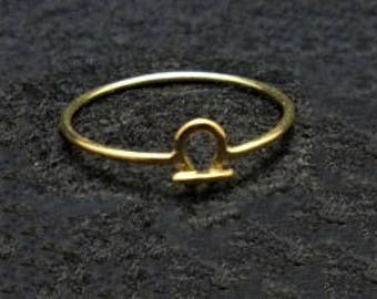 Golden ring solid 18Kt with the symbol of the bring