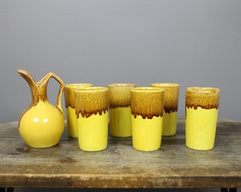 MID-CENTURY WINART yellow with brown drip glaze pottery cup and pitcher set