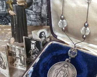 Sterling silver antique Virgin Mary pendant necklace with crystals .