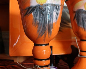 Ceramic Wine Goblet with Pumpkin Head Scarecrow and a Full Moon on Orange Background