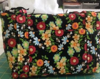 Handmade fabric purse, zippered closure, 2 outside pockets, several pockets inside,