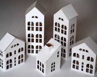 "Pack of 5 DIY Putz style glitter houses. 6"" - 11.8"" tall unassembled corrugated cardboard houses. Make your own decorative house village"