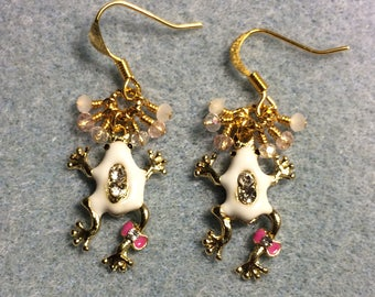 White and pink enamel and rhinestone frog charm earrings adorned with tiny dangling white, pink, and clear Chinese crystal beads.