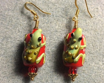 Red and green lampwork lizard bead earrings adorned with red Czech glass beads.