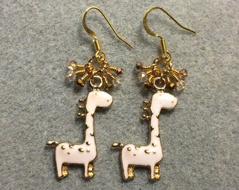 White spotted enamel giraffe charm earrings adorned with tiny dangling clear and gold Chinese crystal beads.