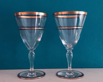 Ten sumptuous Hawkes crystal glasses in the Art-Deco style with black and gold trim