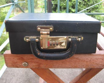 Vintage blue leather beauty case with combination lock.